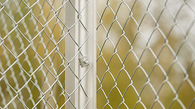 high quality chain link fencing fastened to the aluminium fence post.