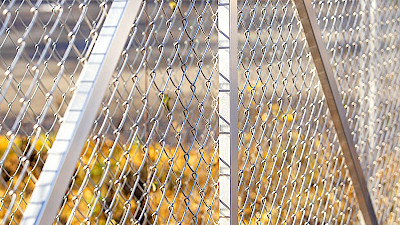 Aluminium supporting posts of a sliding gate with chain link mesh filling