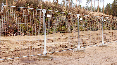 Removable temporary fencing panels with concretes bases.
